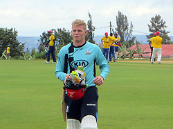 BEST QUALITY AVAILABLE England international Sam Billings walks off after being bowled out during a celebrity T20 match following the official opening of a new cricket stadium in Kigali, Rwanda.
