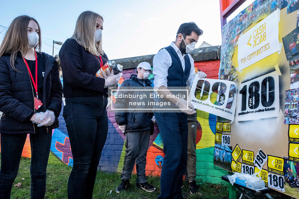 Pictured: Humza Yousaf has a go at getting the brand right<br />