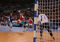 Katerine Fruelund (Denmark) throws for goal.  Denmark v Korea, Womens Handball Final, Athens Olympics, 29/08/2004. Credit: Colorsport / Matthew Impey DIGITAL FILE ONLY
