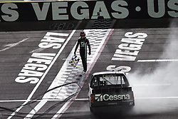 March 1, 2019 - Las Vegas, NV, U.S. - LAS VEGAS, NV - MARCH 01: Kyle Busch (51) Kyle Busch Motorsports (KBM) Toyota Tundra walks down the banking with the checkered flag after winning the NASCAR Gander Outdoors Truck Series The Strat 200 on March 1, 2019, at Las Vegas Motor Speedway in Las Vegas, Nevada. (Photo by Michael Allio/Icon Sportswire) (Credit Image: © Michael Allio/Icon SMI via ZUMA Press)