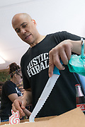 Democratic presidential hopeful Senator Cory Booker cuts his birthday cake after blowing out the candles during a visit to Fresh Future Farm April 27, 2019 in North Charleston, South Carolina. Booker spent his 50th birthday helping out at the urban farm as part of his Justice For All tour.
