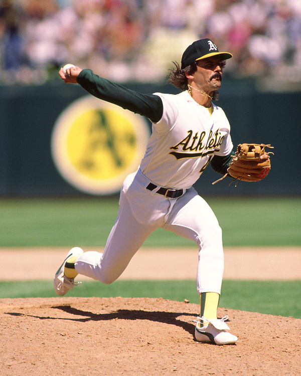 OAKLAND - 1990: Dennis Eckersley of the Oakland Athletics pitches during an MLB game at the Oakland Coliseum during the 1990 season. (Photo by Ron Vesely/MLB Photos via Getty Images)  *** Local Caption *** Jose Canseco