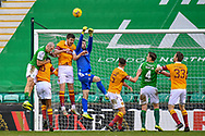 Goalkeeper Liam Kelly (#13) of Motherwell FC punches clear from a corner during the SPFL Premiership match between Hibernian FC and Motherwell FC at Easter Road, Edinburgh, Scotland on 27 February 2021.