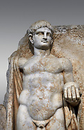 Detail of a Roman Sebasteion relief  sculpture of Emperor Nero with captive, Aphrodisias Museum, Aphrodisias, Turkey. <br /> <br /> Naked warrior emperor Nero holds the orb of world rule in one hand and crowns the military trophy with the other. Between the trophy and the emperor stands a bound captive boy. He wears long barbarian trousers and looks up at Nero. .<br /> <br /> If you prefer to buy from our ALAMY STOCK LIBRARY page at https://www.alamy.com/portfolio/paul-williams-funkystock/greco-roman-sculptures.html . Type -    Aphrodisias     - into LOWER SEARCH WITHIN GALLERY box - Refine search by adding a subject, place, background colour, museum etc.<br /> <br /> Visit our ROMAN WORLD PHOTO COLLECTIONS for more photos to download or buy as wall art prints https://funkystock.photoshelter.com/gallery-collection/The-Romans-Art-Artefacts-Antiquities-Historic-Sites-Pictures-Images/C0000r2uLJJo9_s0