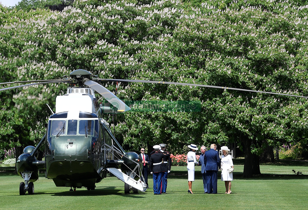 The Prince of Wales and the Duchess of Cornwall meet US President Donald Trump and his wife Melania as they arrive in Marine One at Buckingham Palace, in London on day one of his three day state visit to the UK.