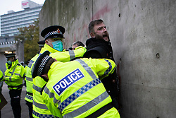 © Licensed to London News Pictures. 08/11/2020. Manchester, UK. Greater Manchester Police make arrests as they act on a dispersal order at Piccadilly Gardens, Manchester as over a thousand attend anti-lockdown protest in Manchester. Photo credit: Kerry Elsworth/LNP