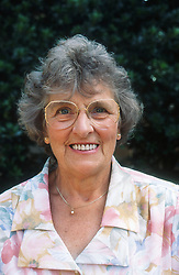 Portrait of elderly woman wearing glasses smiling,