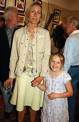 Magazine editor SUSIE FORBES and her daughter EZMI at a an exhibition of prints by art dealer Martin Summers held at 73 Glebe Place, London on 29th June 2004.