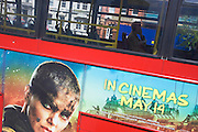 Lone man on central London bus and film advertising.
