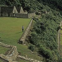 Mysterious terraces and reconstructed buildings dominate Choquequirao, an Inca royal ceremonial site set high on a remote ridge in Peru's rugged Cordillera Vilcabamba.