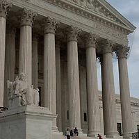 A youngster scampers up the stone stairs of the U.S. Supreme Court building in Washington, DC.