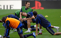 Photo: Richard Lane.<br />Chelsea training session. UEFA Champions League. 30/10/2006. <br />Chelsea's John Terry and Arjen Robben stretch.