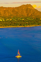 Aerial view of a catamaran cruising from Waikiki Beach with Diamond Head in back, Honolulu, Oahu, Hawaii, USA