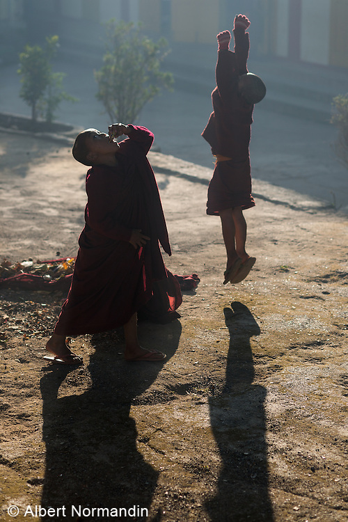 Young Monks playing and jumping at sunrise, Zwé Taw Monastery and Education School