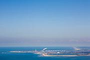 Nederland, Zuid-Holland, Noordzee, 12-06-2009; Maasvlakte gezien vanaf het Haringvliet, links (in zee) wordt gewerkt aan het opspuiten van de tweede Maasvlakte, rechts De Slufter, het depot voor vervuild havenslib. Op het tweede plan en naar de horizon de Delflandse Kust en de kust van Zuid- en Noord-Holland.Swart collectie, luchtfoto (25 procent toeslag); Swart Collection, aerial photo (additional fee required).foto Siebe Swart / photo Siebe Swart