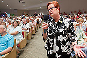 Aug, 25, 2009 -- SUN CITY, AZ: RITA ANDERSON, an emergency room nurse, questions Sen John McCain during the Town Hall meeting on health care sponsored by Sen McCain at Grace Bible Church in Sun City, AZ, Tuesday. More than 1,000 people attended the meeting in the church, which seats 700. Sun City is a staunchly Republican suburb of Phoenix and most of the crowd was opposed to President Obama health care reform efforts.    Photo by Jack Kurtz