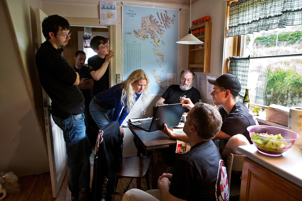 Peter Hammarstedt and the Klaksvik Sea Shepherd volunteer team gather in the kitchen of their home base in Klaksvik after a call from an informer alerting them that pilot whales were spotted in the waters on one of the ferry routes.  The team mobilizes, and waits to hear if further actions will be taken by locals, and if a Grind will happen.  The air is tense, and the team is ready to activate.<br /> <br /> Kaksvik, Streymoy Island, Faroe Islands.