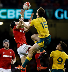 Leigh Halfpenny of Wales and Dane Haylett-Petty of Australia vie for the high ball<br /> <br /> Photographer Simon King/Replay Images<br /> <br /> Under Armour Series - Wales v Australia - Saturday 10th November 2018 - Principality Stadium - Cardiff<br /> <br /> World Copyright © Replay Images . All rights reserved. info@replayimages.co.uk - http://replayimages.co.uk