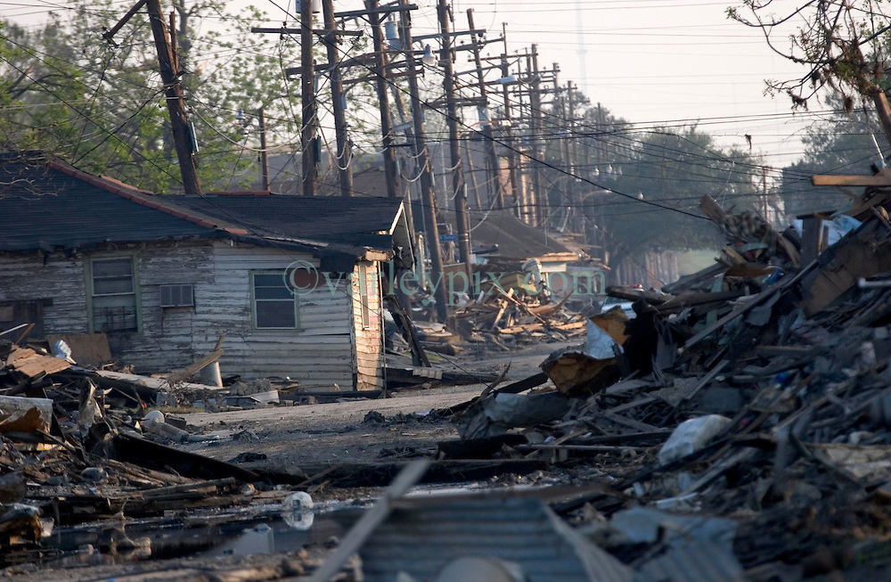 30 Sept, 2005.  New Orleans, Louisiana. Lower 9th ward. Hurricane Katrina aftermath. <br /> The remnants of the lives of ordinary folks, now covered in mud as the flood waters recede. The battered remains of the streets..<br /> Photo; ©Charlie Varley/varleypix.com