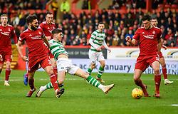Celtic's Ryan Christie has an attempt on goal with Aberdeen's Graeme Shinnie and Aberdeen's Scott McKenna challenging during the Scottish Premiership match at Pittodrie Stadium, Aberdeen