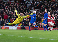 Football - 2017 / 2018 Carabao (EFL/League) Cup - Semi-Final, Second Leg: Arsenal (0) vs. Chelsea (0)<br /> <br /> Wilfredo Caballero (Chelsea FC)  gets a finger tip to a Mesut Ozil (Arsenal FC) shot in the last seconds of the first half at The Emirates.<br /> <br /> COLORSPORT/DANIEL BEARHAM