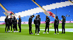 Leicester City players on the pitch before kick-off during the Premier League match at the Cardiff City Stadium, Cardiff.