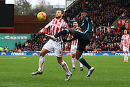 Eric Pieters of Stoke City and Kelechi Iheanacho of Manchester City battle for the ball. Barclays Premier league match, Stoke city v Manchester city at the Britannia Stadium in Stoke on Trent, Staffs on Saturday 5th December 2015.<br /> pic by Chris Stading, Andrew Orchard sports photography.