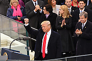 President Donald Trump holds his fist high after taking the oath of office to to become the 45th President of the United States during the Inaugural ceremony January 20, 2017 in Washington, DC.
