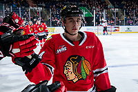KELOWNA, BC - FEBRUARY 8: Seth Jarvis #24 of the Portland Winterhawks fist bumps the bench after scoring a second period goal against the Kelowna Rockets at Prospera Place on February 8, 2020 in Kelowna, Canada. (Photo by Marissa Baecker/Shoot the Breeze)