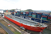 Miaflores Lock, Panama Canal, Panama, April 2014, sequence showing cargo tanker going through lock, 3 of 13 In the Miraflores locks, vessels are lifted (or lowered) 54 feet (16.5 m) in two stages, allowing them to transit to or from the Pacific Ocean port of Balboa in Panama City. Ships cross below the Bridge of the Americas, which connects North and South America.