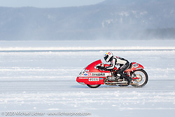 Racer Peter Lapshenkov on his Bonny 3w sidecar bike at the Baikal Mile Ice Speed Festival. Maksimiha, Siberia, Russia. Saturday, February 29, 2020. Photography ©2020 Michael Lichter.