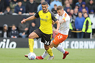 Burton Albion defender Colin Daniel turns from Luton Town forward James Collins during the EFL Sky Bet League 1 match between Burton Albion and Luton Town at the Pirelli Stadium, Burton upon Trent, England on 27 April 2019.