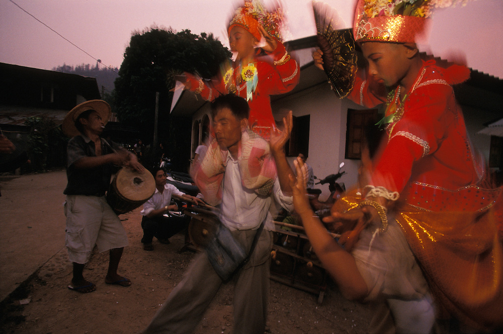 Relatives dance with  boys dressed up as princes on their shoulders at  Poy Sang Long,  a yearly ceremony at which boys are ordained as novice monks, Mae Hong Son, Thailand. The princely clothing is worn in memory of the Buddha who was a prince before becoming a monk. Practically every Shan boy goes through this three-day ceremony sometime between the age of eight and fourteen. After the ordination, the boy spends about one month in a Buddhist monastery and then usually returns to normal life again.
