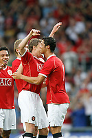 Photo: Marc Atkins.<br />Oxford United v Manchester United XI. Pre Season Friendly. 08/08/2006. Ole Gunnar Solskjaer is congratulated by Christiano Ronaldo after scoring Manchester UNites 1st goal.