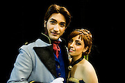 Gabriele and Claudia, both 22 and from Italy, play Prince Hans and princess Anna from Frozen. (GFantasy92@hotmail.it). They have just taken part in the amateur Cosplay parade which allows people to show off their outfits in front of a large crowd. London Film and Comic Con 2014, (LFCC), at Earls Court, London, UK.