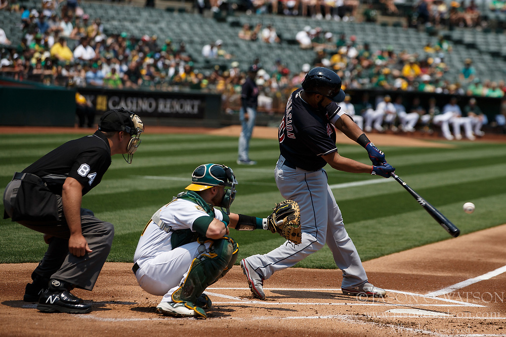 OAKLAND, CA - JULY 01:  Edwin Encarnacion #10 of the Cleveland Indians at bat against the Oakland Athletics during the first inning at the Oakland Coliseum on July 1, 2018 in Oakland, California. The Cleveland Indians defeated the Oakland Athletics 15-3. (Photo by Jason O. Watson/Getty Images) *** Local Caption *** Edwin Encarnacion