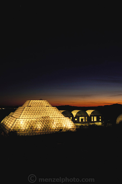 Biosphere 2 Project buildings seen at dusk. The Biosphere was a privately funded experiment, designed to investigate the way in which humans interact with a small self-sufficient ecological environment, and to look at possibilities for future planetary colonization.  1990