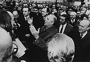 Mikhail Gorbachev taking questions from a crowd on the streets of Moscow.