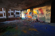 Room full of color pigments smeared on wall and floors at the Packard Plant in Detroit.