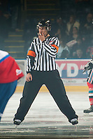 KELOWNA, CANADA - NOVEMBER 7:  Kevin Bennet, referee stands at centre ice as the  Edmonton Oil Kings visit the Kelowna Rockets on November 7, 2012 at Prospera Place in Kelowna, British Columbia, Canada (Photo by Marissa Baecker/Shoot the Breeze) *** Local Caption ***