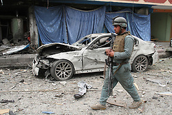 An Afghan security force member walks at the site of an attack in Jalalabad city, eastern Afghanistan, March 2, 2016. About six persons, including four attackers, were killed and 19 people wounded when gunmen attacked an Indian Consulate office in eastern Afghanistan's Jalalabad city on Wednesday, police said. EXPA Pictures © 2016, PhotoCredit: EXPA/ Photoshot/ Rahman Safi<br /><br />*****ATTENTION - for AUT, SLO, CRO, SRB, BIH, MAZ only*****