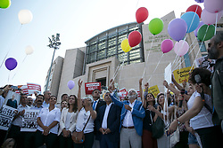 People and Journalists from daily opposition newspaper Cumhuriyet prepare to free colored air balloons as they shout slogans during a gathering on July 24, 2017 in front of Istanbul`s courthouse.