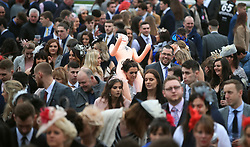Crowdgoers during Ladies Day of the 2018 Randox Health Grand National Festival at Aintree Racecourse, Liverpool.
