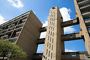 Carradale House, adjacent to Balfron Tower, on 27th April 2016 in London, United Kingdom. The architecturally important Balfron Tower is a 26-storey residential building in Poplar, a district of the London Borough of Tower Hamlets in the East End of London. It was designed by Ernő Goldfinger and built in a brutalist style for the London Country Council. It and opened in 1967. The tower forms part of the Brownfield Estate. It has been a Grade II listed building since 1996. Balfron Tower is stylistically similar to Goldfingers later Trellick Tower in West London. Recently, residents and campaigners are battling to prevent a regeneration of the celebrated tower.