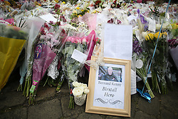 © Licensed to London News Pictures. 23/06/2016. Birstall, UK. A framed photograph of Bernad Kenny, who tried to fight of Jo Cox's attacker, lays at the town centre of Birstall where she was killed. Mourners gathered in Birstall, West Yorkshire, today a week to the day that Labour MP was shot and killed in the town. A one minutes silence was held at 13.50, the time that Jo was attacked last week outside her constituency surgery . Photo credit : Ian Hinchliffe/LNP