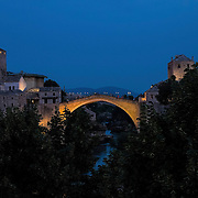 MOSTAR, BOSNIA AND HERZEGOVINA - JUNE 28:  A general view of the Old Bridge seen on June 28, 2013 in Mostar, Bosnia and Herzegovina. The Siege of Mostar reached its peak and more cruent time during 1993. Initially, it involved the Croatian Defence Council (HVO) and the 4th Corps of the ARBiH fighting against the Yugoslav People's Army (JNA) later Croats and Muslim Bosnian began to fight amongst each other, it ended with Bosnia and Herzegovina declaring independence from Yugoslavia.  (Photo by Marco Secchi/Getty Images)
