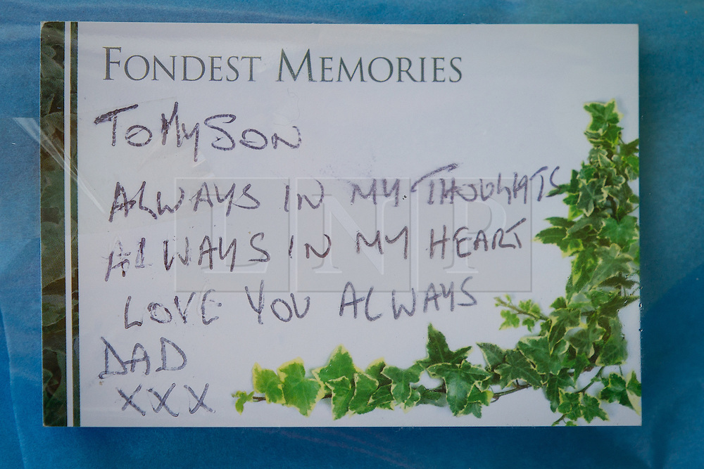 © Licensed to London News Pictures . 12/07/2013 . Manchester , UK . Card from Jordan's father . Flowers and tributes at the scene on 5 Beard Road , Gorton , Manchester , for Jordan Begley , who died on Wednesday evening (10th July 2013) after a taser was used on him by police . Police reported the incident , which has been referred to the IPCC , occurred at 20:15 after they responded to a disturbance involving a man with a knife . Photo credit : Joel Goodman/LNP