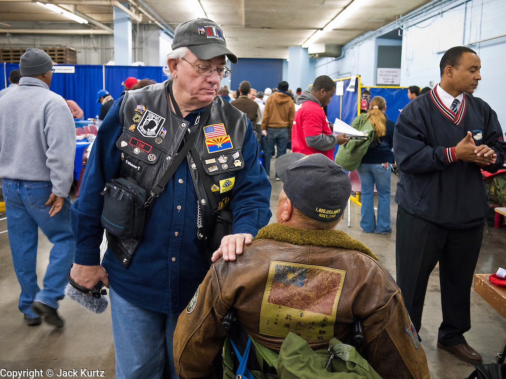 04 FEBRUARY 2011 - PHOENIX, AZ: An Arizona StandDown volunteer greets a veteran at the Arizona StandDown in Phoenix Friday. The ArizonaStandDown is an annualthree day event that brings together theValley's homeless and at-risk militaryveterans, connecting themwith services ranging from: VA HealthCare, mental health services, clothing, meals, emergency shelter, transitional and permanent housing,ID/ drivers license's, court services and Legal Aide, showers, haircuts and myriad other services and resources. Arizona StandDown isheld annually at theVeterans Memorial Coliseum at the Arizona State Fairgrounds in Phoenixon Super Bowl weekend.    Photo by Jack Kurtz
