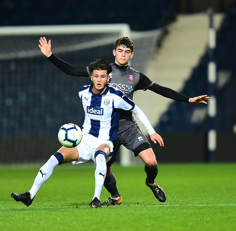 West Bromwich Albion U18's Jamie Soule shields the ball from  Lincoln City U18's Gianluca Bucci<br /> <br /> Photographer Andrew Vaughan/CameraSport<br /> <br /> FA Youth Cup Round Three - West Bromwich Albion U18 v Lincoln City U18 - Tuesday 11th December 2018 - The Hawthorns - West Bromwich<br />  <br /> World Copyright © 2018 CameraSport. All rights reserved. 43 Linden Ave. Countesthorpe. Leicester. England. LE8 5PG - Tel: +44 (0) 116 277 4147 - admin@camerasport.com - www.camerasport.com