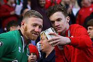 Alan Power of Lincoln City has a photo with a fan after the final whistle. The Emirates FA cup 5th round match, Burnley v Lincoln City at Turf Moor in Burnley, Lancs on Saturday 18th February 2017.<br /> pic by Chris Stading, Andrew Orchard Sports Photography.
